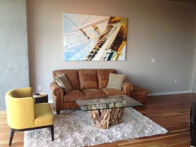 Modern art and furniture chosen specifically for Denver loft living, using natural materials of leather, glass, steel, and wood.