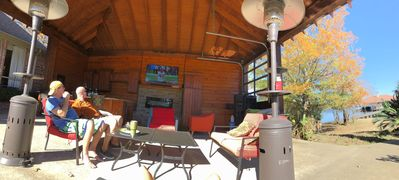 """Enjoy the outdoors kitchen and seating area with the 55"""" LED TV"""