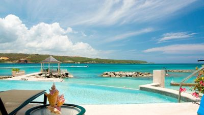Photo for SUGAR BAY ON THE BEACH JAMAICA - Luxury 5 Bedroom Beachfront Villa in Discovery Bay - Staff inc