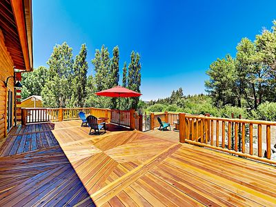 Deck - Forest and mountain views await on the custom wraparound deck.