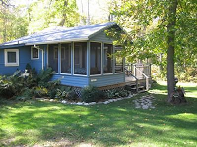 Photo for Get away at this quaint cottage tucked behind a beautiful fern bed.