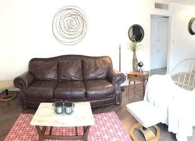 Living Room, with a Modern Bohemian Decor. Wood and Leather Furnishings.
