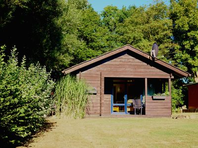 Photo for Log cabin with large garden - wifi included - only 5 minutes to the beach