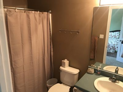 Guest room bathroom with rounded out shower curtain rod