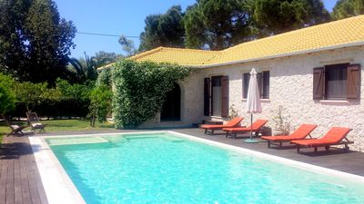 Photo for Secluded, luxurius, private, large pool, walk to beach