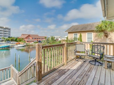 Photo for Bright and airy canalside townhome w/ large deck, boat slips, and harbor view