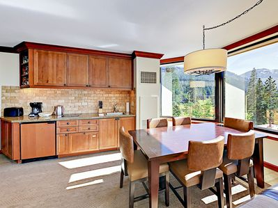 Dining Area - Your rental will include the TurnKey HomeDroid tablet, a guest directory with specific home details (e.g., TV instructions) and area activities/suggestions.