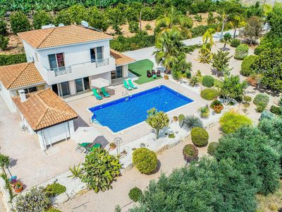 Photo for Modern villa with great gardens, a pool and Wi-Fi, close to popular beaches and resort