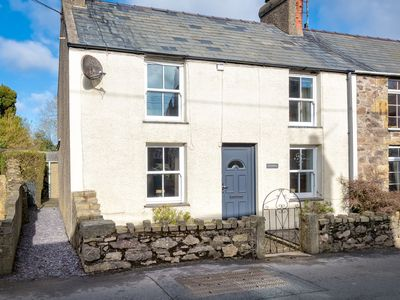 Photo for This pretty painted end terrace cottage presents a stylish, warm and welcoming home from home with a