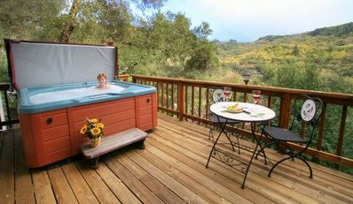 Lower deck faces the Russian River valley. Hot tub, bistro table and swing.