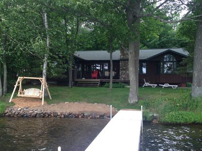 Lake side of the cabin. Beach area for the kids, swing and lakeside deck.