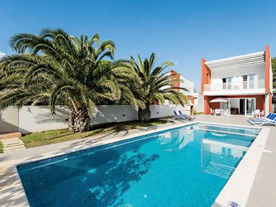 Photo for Striking red villa, one of two identical properties, w/ pool, air con + sea views