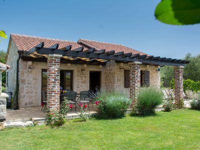 Photo for Authentic stone house with private garden, roofed terrace, BBQ, 80m from the sea