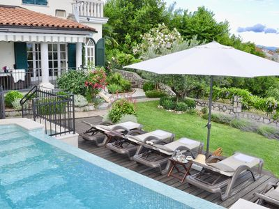 Photo for Holiday house with heated infinity pool and sea views