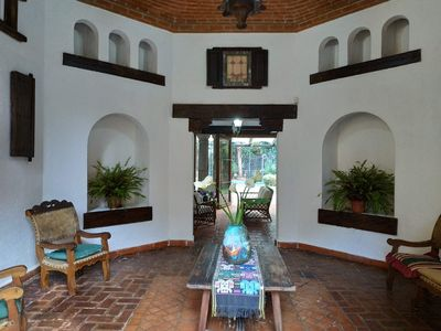 Foyer looking from the front door entrance towards the living area &  back patio
