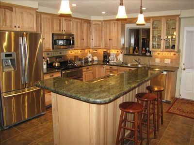 New kitchen with granite tops, hickory cabinets and stainless appliances