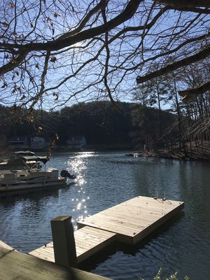 Photo for Lake Front in Cove.....Pet Friendly With Huge, Enclosed Water Level Deck