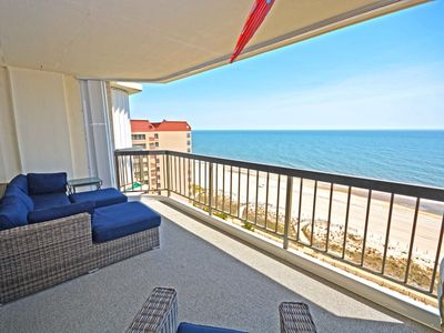 Photo for Laid-back and spacious, this two-bedroom oceanfront condo has cute beach decor, free WiFi, an amazing view of the ocean, and an outdoor pool and is located uptown!