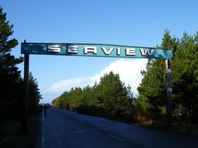 We are adjacent to the Seaview approach road; drive to and on the beach