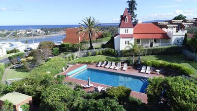 Heated year round swimming pool  with views and elevated sunbathing areas in the