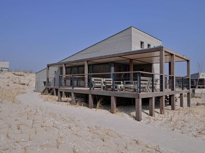 Photo for Luxurious villa with a nice deck, in nature reserve De Punt