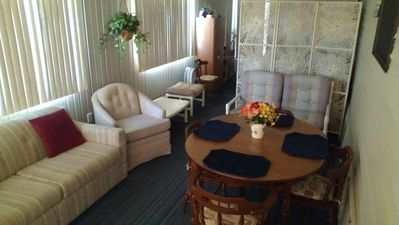 Florida Room dining and seating area. Small TV, Washer / Dryer and full size bed