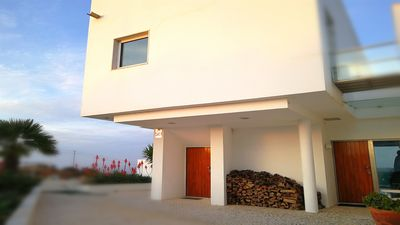 Photo for Cozy villa 700m from the beach with great mountain and sea views