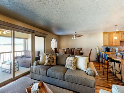 Photo for Lovely waterfront condo w/ a shared seasonal pool - close to town & skiing!