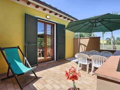 Photo for Holiday apartment with terrace and garden - Villa I Gelsi - Bilo 2