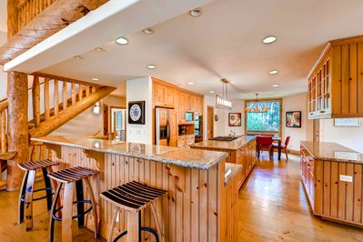 View into the Spacious Kitchen - with two sinks, double ovens, gas cooktop, bar seating - located adjacent to Kitchen is the Breakfast Nook and Dining Area