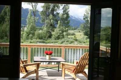 inviting view from inside of the deck, pond and Tetons.