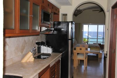 Kitchen to dining area to bed to the view