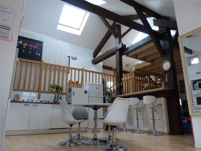 Photo for Loft 130 m² - quiet in the city center - shared garden - WiFi