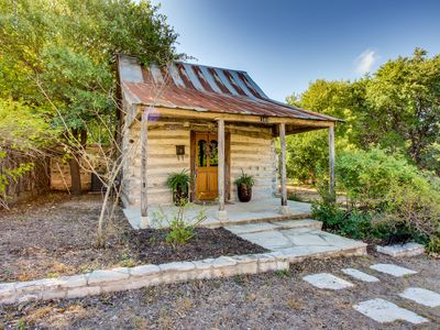 Photo for Historic tin roof log cabin with updated amenities - deep in the heart of Texas