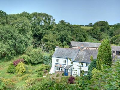 Photo for 17th-century farmhouse offering magnificent views across natural surroundings in Devon