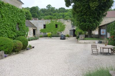 The large enclosed courtyard of which Spring Cottage is on the right hand side
