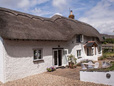 Photo for Four Oaks. Pretty thatched Cottage with Summer house and Hot Tub