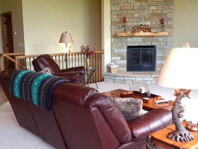 Living area opens to extensive balcony and lower level