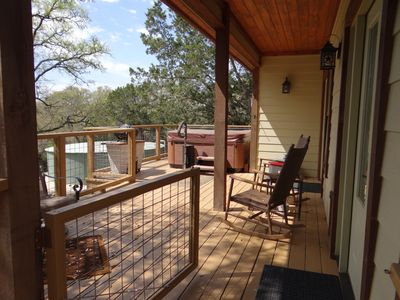 Photo for Charming Home with large private deck & hot tub in the heart of the Hill Country