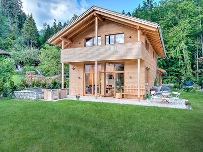 Photo for Luxury design wooden house with flair in Bavaria with sauna, garden and mountain views