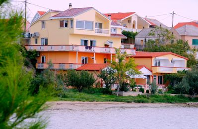Photo for Apartments with private beach in quiet village