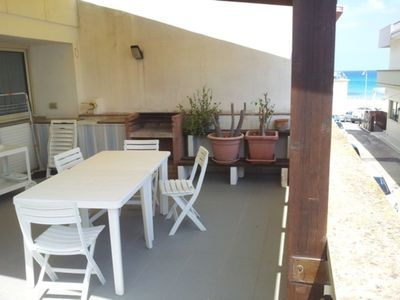 Photo for Apartment Directly on the Beach with Air Conditioning and Terrace; Pets Allowed