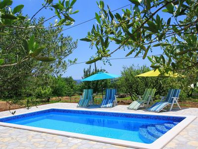 Photo for Beautiful apartment for 8 guests with A/C, private pool, WIFI, TV and parking