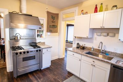 Cook your favorite meals on the gas stove with a griddle in the new kitchen.