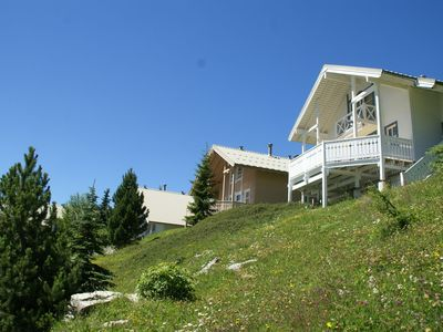 Photo for Comfortable Scandinavian chalet with shared heated, panoramic pool.