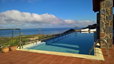 Photo for Oasis of tranquility, fabulous sea views, large heated pool and outdoor spa