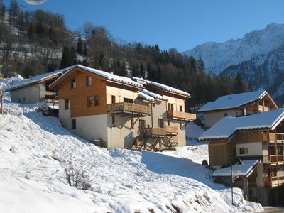 Photo for Catered ski holiday in spacious chalet with hot tub - 1 minute from ski lift