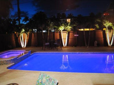 Beautiful night time lighting by the pool.