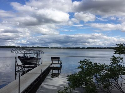 level lake entry with private dock and bench (boat lift not available)