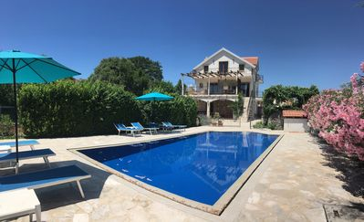 Villa over looking deck level pool with sun terraces and beautiful garden